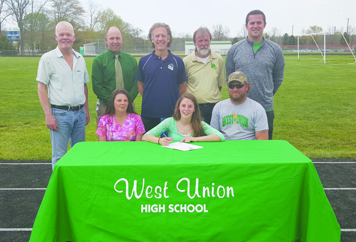 Present at last week's college signing ceremony were: Front row, from left, Rebecca Hackworth (mother), Ashley Hackworth, and Derrick Hackworth (father); Back row, from left, Buddy Niece, WUHS Track Coach, Ben King, WUHS Principal, Eric Putnam, Shawnee State Cross-Country and Track Coach, Jason Little, WUHS Track Coach, and Sean INman, WUHS Cross-Country Coach.  Photo by Mark Carpenter