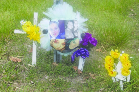 A memorial to the Rhoden family was placed at the intersection of Union Hill Road and State Route 32. Photo by Patricia Beech