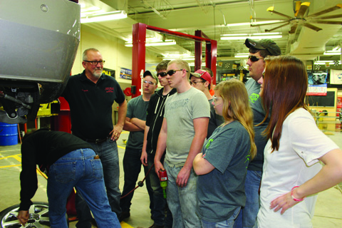 Students in the Automotive Training Program at the OVCTC are changing a tire as instructor Joe Palmer supervises.  Photo by Patricia Beech.