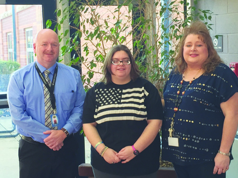 Larry Heller, Manchester Lions Club President, Annie Estes, and Becky Armstrong.