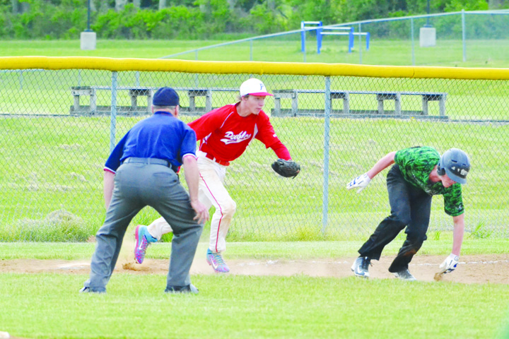 Peebles third baseman Levi Newkirk chases down this Western base runner as the beginning of a crucial seventh inning double play in the Indians' 5-2 sectional tournament win over Western Latham on May 7.  Photo by Mark Carpenter.