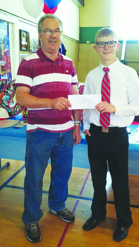 Peebles High School senior Joe McElwee is the recipient of this year's Sons of the American Legion scholarship. Here, McElwee, right, is presented the scholarship by Terry Sowards from the Sons of the American Legion.