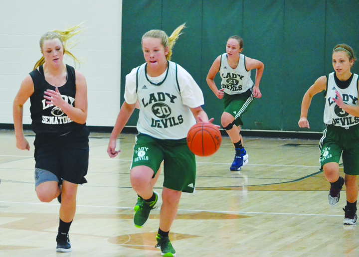 North Adams' Courtney Brown heads up court with teammates trailing in action from the June 24 JV Shootout.