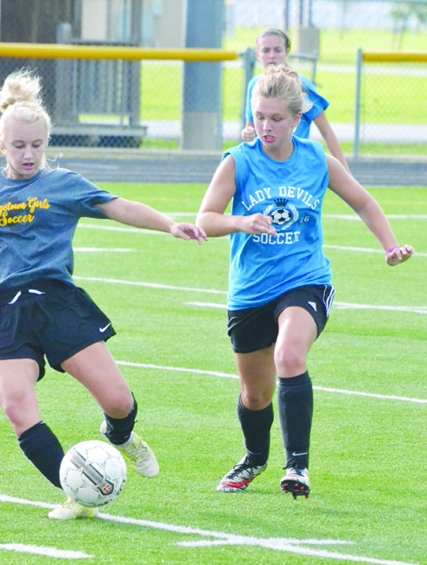 Jordyn Kell, battling for possession here against Georgetown, will be one of the top returning girls soccer players in the SHAC in 2016.