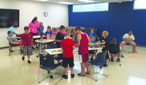 Here, the youngsters in the Summer R.E.C. program are designing and building roller coasters with engineering kits.