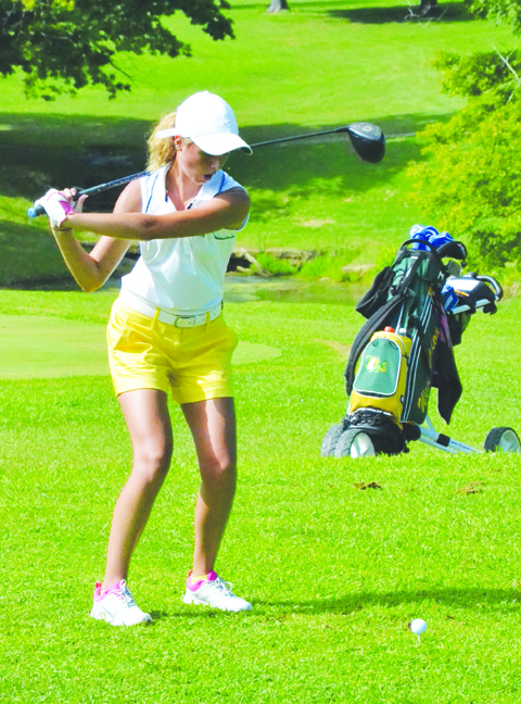 West Union's Lucy Kersey tees off on hole number one at the Adams County Country Club during last week's girls' golf match.