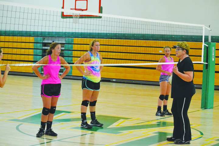 West Union varsity volleyball coach Debbie McClanahan gives instructions to her squad on Monday night, the first official day of practice for volleyball teams.