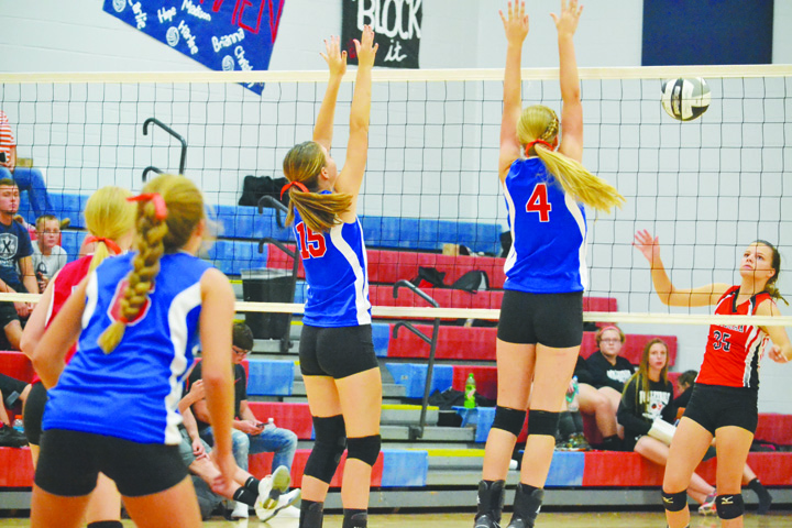 Up at the net for a block in last week's match with Whiteoak are Peebles' Jessica Johnson, left, and Josie Myers (4).  The Lady Indians got their first SHAC win of 2016, downing the Lady Cats in four sets.