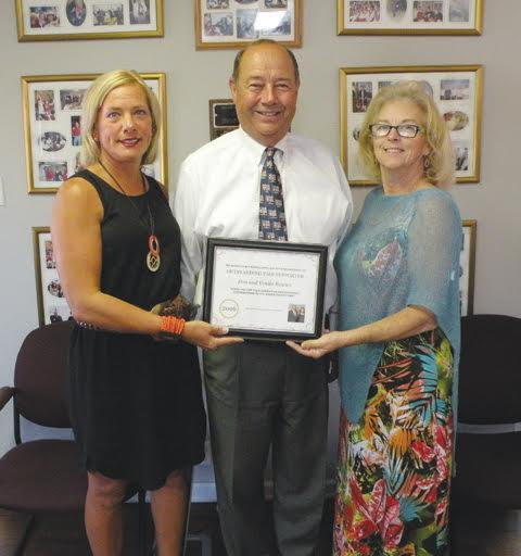 Pictured with Adams County Agricultural Society President Liz Lafferty, left, are the 2016 Outstanding Fair Supporters, Don and Venita Bowles.