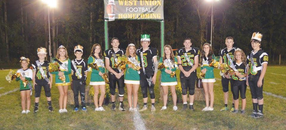 Before their game last Friday night at Freedom Field with Eastern Brown, the West Union football program held its 2016 Homecoming ceremonies.  Here is the entire court, from left: Little Princess Lily Reed, Little Prince Gavin Jarvis, Junior High Princess Lindsey Taylor, Junior High Prince Brian Hunt, High School candidates Makenzee Davis and Tyler Rothwell, 2016 Queen Morgan Henry, 2016 King Ryan Rothwell, High School candidates Cassidy Blythe, Chris Silhavy, Braydan Gaffin, and Zack Best, Duchess Trinity Thomas, and Duke Nick Weaver.