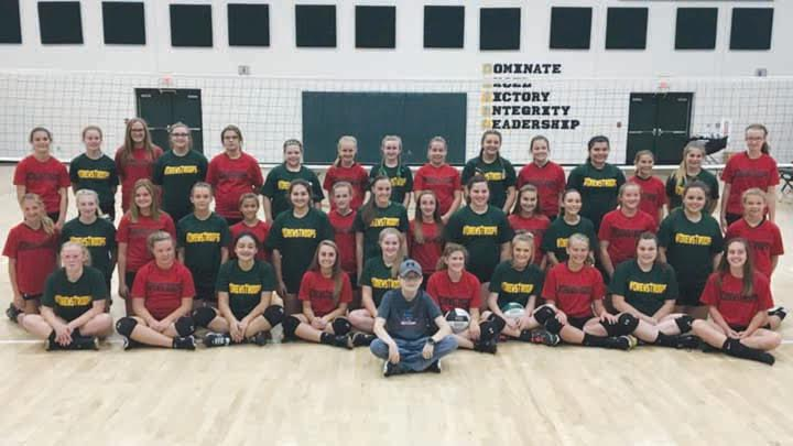 """A junior high volleyball match on Sept. 19 at North Adams High School was a special evening as it was """"Drew's Troops"""" Night as the Lady Devils entertained Fairfield.  The junior high teams, pictured above with NAES student Drew Reid in front, battled it out on the court but all the proceeds from the night went to part of Drew's battle with cancer, all of the money going to the Ronald McDonald House in Drew's name, a job well done by all."""