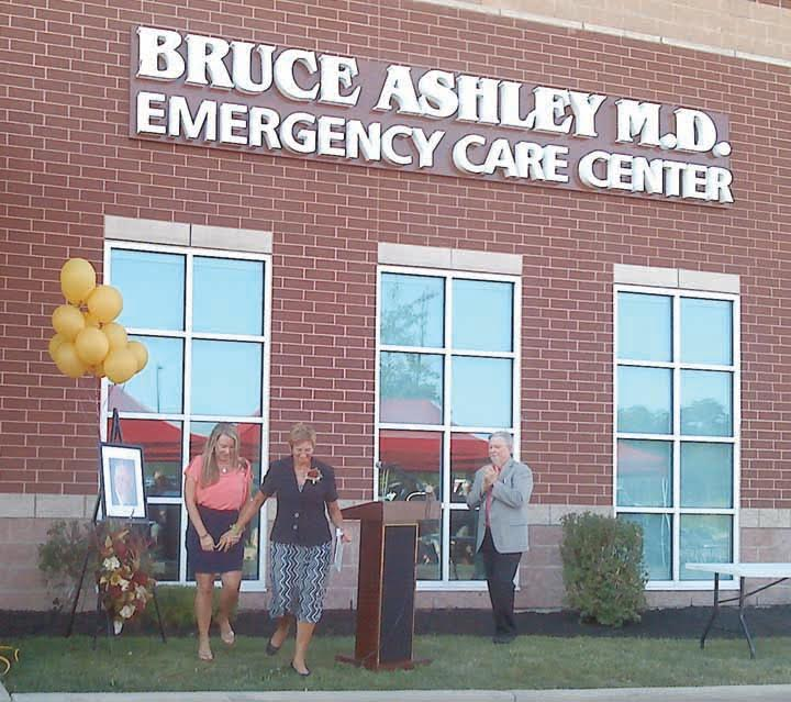 """On Sept. 22, the Adams County Regional Medical Center held a ceremony to honor a special man and to rename the hospital's emergency room in his honor.  Dr. Bruce Ashley served the Adams County community for many years before unexpectedly passing away and in his honor, the ceremony on Thursday christened the new """"Bruce Ashley, M.D. Emergency Care Center.""""  Pictured above at the dedication ceremoney are, from left, daughter Jade Ashley, wife Sharon Ashley, and ACRMC CEO Roland Gee.  Photo by Kaiajade for The People's Defender"""