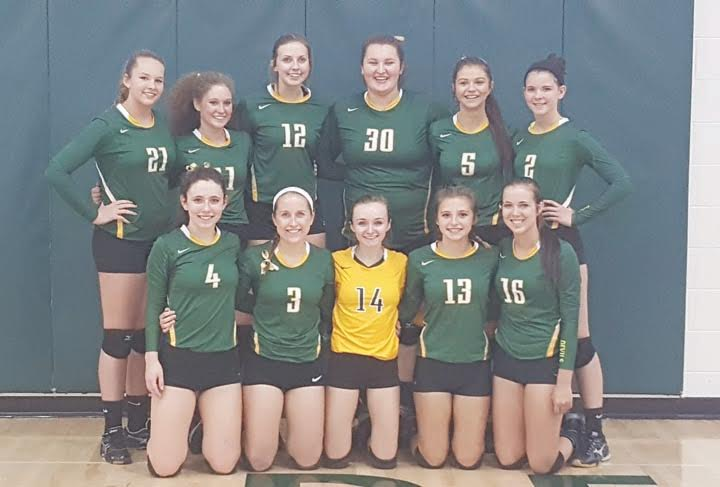 For the fourth consecutive season, the North Adams Lady Devils volleyball squad will receive the golf ball trophy for going undefeated in the Southern Hills Athletic Conference.  They are pictured here after defeating Ripley for their 52nd consecutive victory.  Front row, from left, Sydney Kendall, Adison Wright, Maddie Toole, Abbi Stacy, and Brooklyn Stout; Back row, from left, Courtney Brown, Abby Campton, Madison Jenkins, Avery Harper, Charlee Louden, and Desirae Ison.