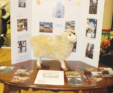"""One of the unique items at the Howl-O-Ween Auction was the """"Keep the Sheep.""""  The winning bidder keeps the stuffed sheep for a year, documents all its travels, then brings it back next year to be auctioned again."""
