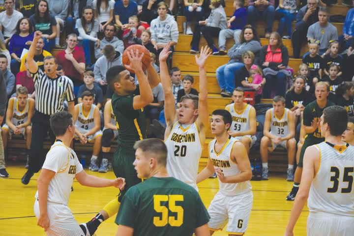 North Adams point guard Isaiah Anderson slices through the Georgetown defense on his way to the basket during action from the Nov. 11 Foundation Game. Anderson racked up 30 points as the Devils slipped past the host G-Men 60-58.