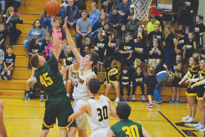 North Adams' Elijah Young, left, looks for room around the defense of Georgetown's Cameron Brookbank in action from the Nov. 11 Foundation Game.